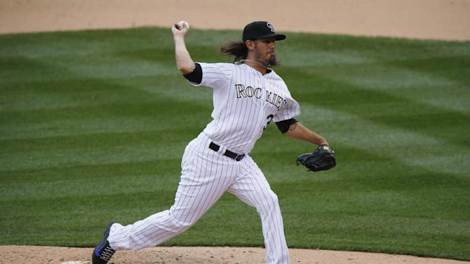 Colorado Rockies relief pitcher Christian Bergman works against the Arizona Diamondbacks in the fourth inning of the first game of a baseball doubleheader Wednesday, May 6, 2015, in Denver. (AP Photo/David Zalubowski)