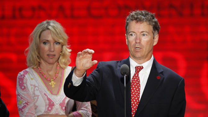 Sen. Rand Paul, R-Ky., is joined by his wife Kelley as he checks out the stage at the Republican National Convention inside the Tampa Bay Times Forum, Sunday, Aug. 26, 2012, in Tampa, Fla.  (AP Photo/J. Scott Applewhite)