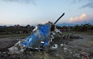 "The mangled tail section of the crashed Sita Air Dornier Do 228 aircraft in Manohara, on the outskirts of Kathmandu. Nepal said an error by a ""panic-stricken"" pilot likely caused the crash of an Everest-bound plane that killed all 19 on board"