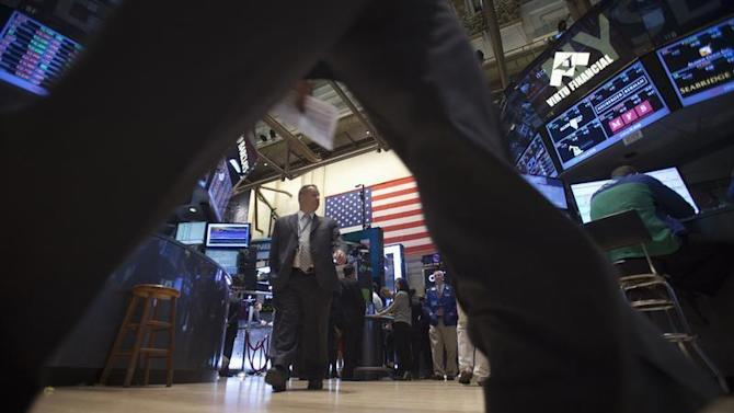 Traders walk the floor of the New York Stock Exchange at the market open in New York