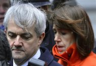 Chris Huhne, Britain's former energy secretary, is accompanied by his partner Carina Trimingham, as he arrives to be sentenced at Southwark Crown Court in London March 11, 2013. REUTERS/Toby Melville