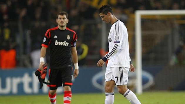 Real Madrid's Cristiano Ronaldo (R) and goalkeeper Iker Casillas walk off the pitch after defeat to Borussia Dortmund (Reuters)