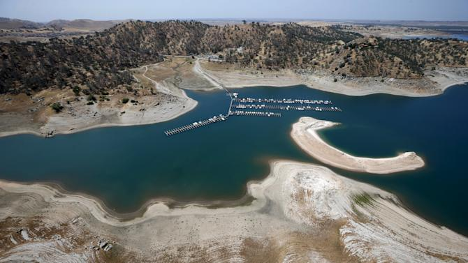 Reservoir banks that used to be underwater are seen at Millerton Lake, on the San Joaquin River, in Friant