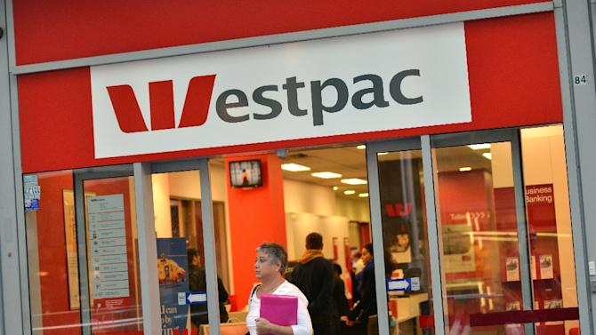 A woman walks out of a Westpac Bank in the central business district of Sydney on May 5, 2014