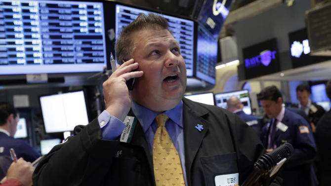 Trader George Ettinger works on the floor of the New York Stock Exchange Monday, April 29, 2013.  A pair of encouraging economic reports helped propel the stock market up in early trading on Monday. (AP Photo/Richard Drew)
