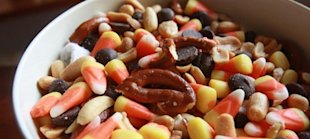The popular Halloween staple candy corn is used to make a salty trail mix - an ideal all-natural give away to trick-or-treaters.