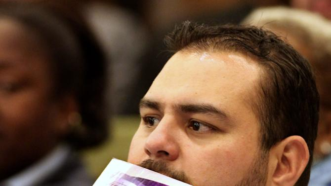 A supporter of a new sports and entertainment center, holding a card with an illustration of the new arena, listens to the discussion of the arena plan by the Sacramento City Council, during a meeting in Sacramento, Calif. Tuesday, March 6, 2012. A year after the NBA's Sacramento Kings almost moved to Anaheim, Sacramento's plan to help finance a new $391 million arena was a vote away from approval Tuesday night. (AP Photo/Rich Pedroncelli)