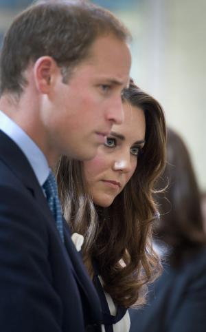 The Duke and Duchess of Cambridge  talks to local people as they visit Summerfield Community Center, Birmingham, England Friday Aug. 19, 2011 which was a very badly affected by unrest that swept London and other major cities last week. Prince William and his wife Kate, the Duchess of Cambridge, visited a community center in the English city of Birmingham, where three men were killed in a hit-and-run during last week's violence. The couple spent 15 minutes speaking with families of the victims and greeted emergency workers and locals at the city's Summerfield Community Center.   (AP Photo/Geoff Pugh, Pool)