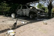 A burnt car at the US consulate compound in Benghazi on September 13, 2012. Ambassador Chris Stevens and three other US diplomatic staff died when dozens of men wielding heavy arms overran the compound on September 11, 2012