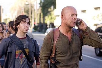 Justin Long and Bruce Willis in 20th Century Fox's Live Free or Die Hard