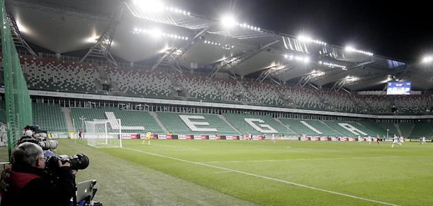 Legia Warszawa and Apollon Limassol FC players vie for the ball during their Group J Europa League soccer game at the empty Pepsi Arena stadium in Warsaw, Poland, Thursday, Oct. 3, 2013. UEFA ordered