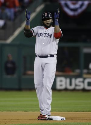 Boston Red Sox designated hitter David Ortiz applauds after hitting an RBI double during the first inning of Game 5 of baseball's World Series against the St. Louis Cardinals Monday, Oct. 28, 2013, in St. Louis. (AP Photo/Matt Slocum)
