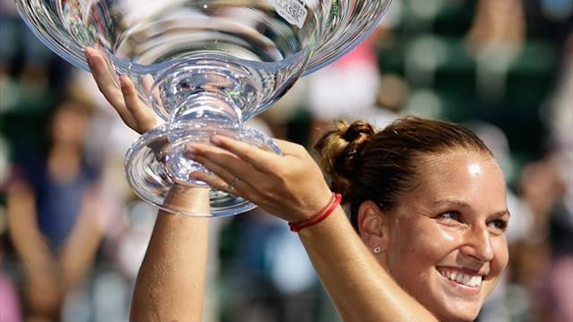 Dominika Cibulkova kisses the trophy after beating Agnieszka Radwanska of Poland in the finals (AFP)