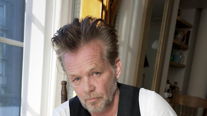 """FILE - In this Sept. 22, 2014 file photo, singer-songwriter John Mellencamp poses for a portrait to promote his 22nd album """"Plain Spoken"""" at the Greenwich Hotel in New York. (Photo by Amy Sussman/Invision/AP, File)"""