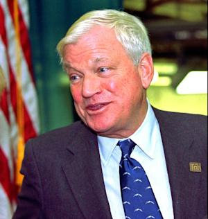 FILE - In this Oct. 23, 1997, file photo, billionaire Richard Mellon Scaife, owner and publisher of the Tribune Review newspapers in Pittsburgh and Greensburg, Pa., greets visitors as they enter the paper's new facility in Warrendale, Pa. during the dedication of the building. Scaife, who published the Pittsburgh Tribune-Review and funded libertarian and conservative political causes, including a one-time effort to discredit President Bill Clinton, died at his home early Friday, July 4, 2014, one day after his birthday, The Tribune-Review newspaper reported. He was 82. In 2013, Forbes estimated his wealth at $1.4 billion. (AP Photo/Keith Srakocic, File)