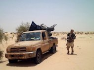 An Islamist rebel of Ansar Dine is pictured near Timbuktu in April. Mali's Tuareg rebels clashed overnight with their former Islamist allies, witnesses said Friday, after the two groups fell out over forming a breakaway state in the northern desert region they control