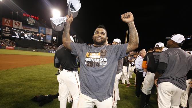Giants hold off Padres after clinching playoffs