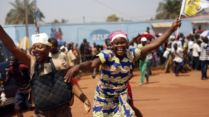 People cheer at Pope Francis upon his arrival in Bangui, Central African Republic, Sunday, Nov. 29, 2015. The Pope has landed in the capital of Central African Republic, his final stop in Africa and where he will seek to heal a country wracked by conflict between Muslims and Christians. (AP Photo/Jerome Delay)