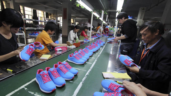 Chinese workers manufacture sports shoes at a shoe factory in Jinjiang in southeast China's Fujian province Friday Nov. 9, 2012. China's auto sales, consumer spending and factory output improved in October in a new sign of economic recovery as the Communist Party prepared to install a new generation of leaders. Growth in factory output accelerated to 9.6 percent over a year earlier from the previous month's 9.2 percent, the government reported Friday. (AP Photo) CHINA OUT