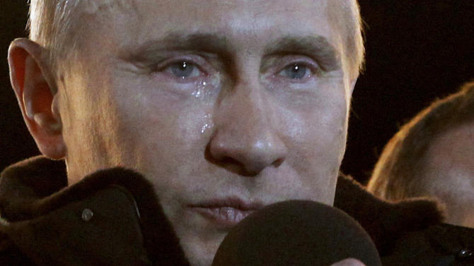 FILE This  Sunday, March 4, 2012 file photo shows Russian Prime Minister Vladimir Putin, who claimed victory in Russia's presidential election, with tears running down his face up as he reacts at a massive rally of his supporters at Manezh square outside Kremlin, in Moscow. It seems a strange sight: The president of the United States, sometimes called the most powerful person in the world, breaking down in tears thanking campaign workers for their tireless _ and ultimately successful _ work on his behalf. But Barack Obama isn't the only world leader unashamed or unable to avoid being seen crying in public.  Putin is a judo fan and hunting aficionado known in part for his physical fitness. But that didn't stop him from welling up with tears in March after he was returned to power in a difficult election battle marred by public protests.(AP Photo/Ivan Sekretarev)