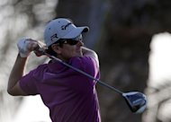 England's Justin Rose plays a shot during the first round of the Abu Dhabi Golf Championship at the Abu Dhabi Golf Club in the Emirati capital on January 17, 2013. Rose grabbed a share of the first round lead in the Abu Dhabi Golf Championship on a day when both Rory McIlroy and Tiger Woods struggled to get their seasons into gear