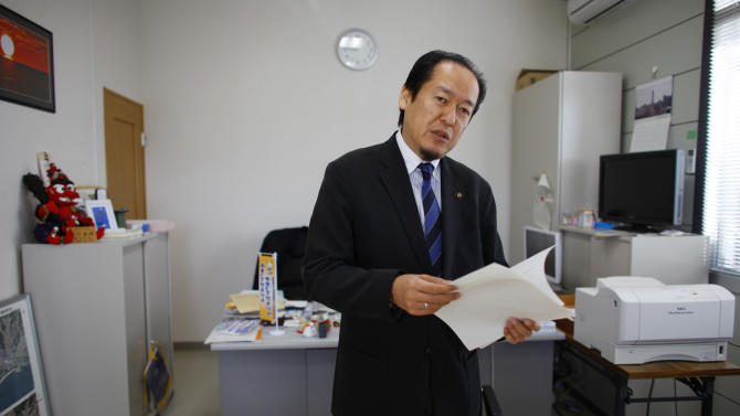 In this Friday, Feb. 22, 2013 photo, Futoshi Toba, Mayor of Rikuzentakata, a city devastated by the March 11, 2011 earthquake and tsunami, speaks during an interview at his office in Rikuzentakata, Iwate Prefecture, northeastern Japan. Toba, who lost his wife Kumi in the tsunami, is among many who believe reconstruction has been hobbled by Japan's incapacity to shift gears and adapt quickly enough to changes brought on by the tsunami - just as it is struggling to revive its fast aging, post-industrial economy. (AP Photo/Junji Kurokawa)