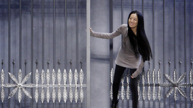 FILE - This Feb. 15, 2011 file photo shows designer Vera Wang acknowledging audience applause after her fall 2011 collection was modeled during Fashion Week in New York.  Wang, 63, was honored for her lifetime achievement by the Council of Fashion Designers at its star-studded awards show Monday night. She received the award from her former employer and mentor Ralph Lauren, and she received a standing ovation from her peers.  (AP Photo/Richard Drew, file)