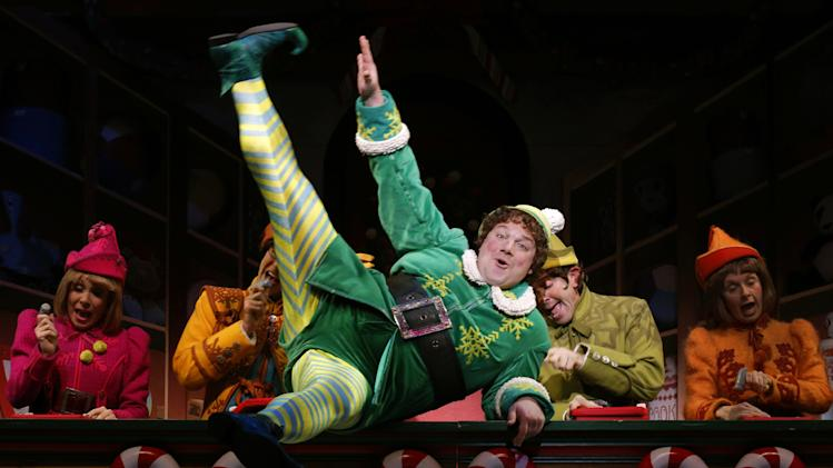 """This theater image released by The Hartman Group shows Jordan Gelber, center, during a performance of the musical """"Elf,"""" in New York. (AP Photo/The Hartman Group, Joan Marcus)"""