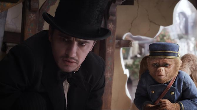 "FILE - This file film image provided by Disney Enterprises shows James Franco, as Oz, left, and the character Finley, voiced by Zach Braff, in a scene from ""Oz the Great and Powerful."" ""Oz the Great and Powerful"" is living up to its name at the box office. Walt Disney's 3-D blockbuster has led all films for the second week in a row, taking in $42.2 million according to studio estimates Sunday, March 17, 2013. Sam Raimi's prequel to the L. Frank Baum classic ""The Wonderful Wizard of Oz"" also took in $46.6 million overseas, leading to two-week worldwide total of $281.8 million. (AP Photo/Disney Enterprises, File)"