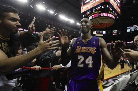 Los Angeles Lakers Bryant leaves the court against the Portland Trail Blazers after their NBA game in Portland