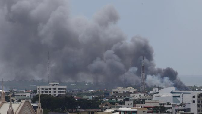 Smoke billows from downtown Zamboanga city, as fighting rages between government soldiers and the Muslim rebels of the MNLF