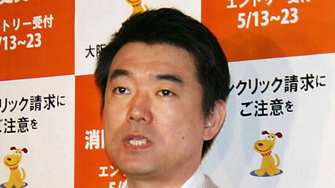 "In this May 13, 2013 photo, Osaka Mayor Toru Hashimoto answers reporters' questions at the Osaka city office in Osaka, western Japan.  Osaka's outspoken mayor has said the system in which Asian women were forced to become wartime prostitutes before and during World War II was necessary to ""maintain discipline"" in the Japanese military.   (AP Photo/Kyodo News) JAPAN OUT, MANDATORY CREDIT"