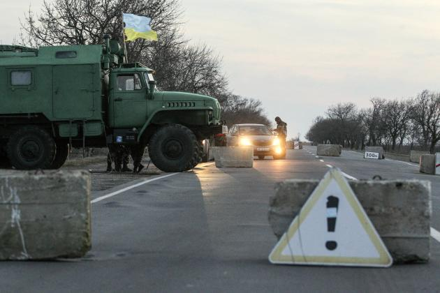 Ukrainian soldiers man a checkpoint near the village of Chongar