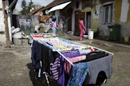 Laundry is laid out to try in front of a poor family's home in Miskolc, Hungary on April 22, 2012. Nationally, unemployment runs at around 11%, but in the northeast it is over 30%, and reaches 80 or even 100% in the most remote villages