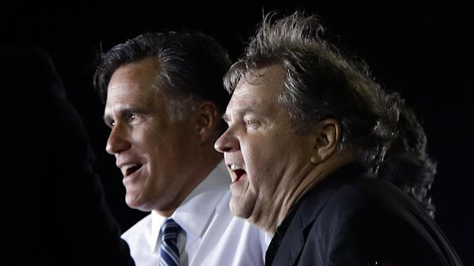 """Republican presidential candidate and former Massachusetts Gov. Mitt Romney sings """"God Bless America"""" with Meat Loaf as he campaigns at the football stadium at Defiance High School in Defiance, Ohio, Thursday, Oct. 25, 2012. (AP Photo/Charles Dharapak)"""