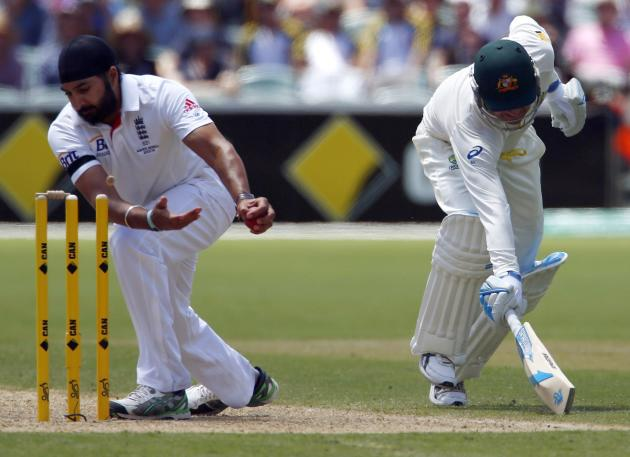 England's Panesar breaks the bails off the wickets in an unsuccessful attempt to run out Australia's captain Clarke during second day's play in second Ashes cricket test at Adelaide Oval