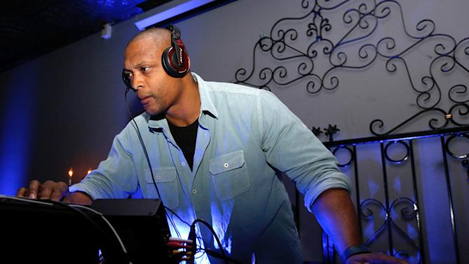 IMAGE DISTRIBUTED FOR PREMIERE GLOBAL SPORTS - Former NFL player Eddie George can be seen as a D.J. at the Premiere Global Sports Balcony Over Bourbon Party in New Orleans, Louisiana on Friday, Feb. 1, 2013. (Scott Boehm /AP Images for Premiere Global Sports)