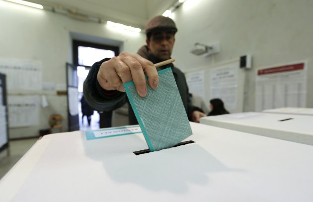 A man casts his vote at a polling station in Rome