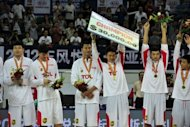 Chinese players celebrate after winning the Stankovic Continental Cup. China used size, speed and 14 points from Dallas Maverick Yi Jianlian to outclass Australia 70-51 Tuesday to win the Stankovic Continental Cup, a warm-up tournament for the London Olympics