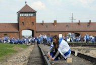 Young Jews place memory plaques on railway tracks at the Auschwitz Nazi death camp in Oswiecim, southern Poland, at a ceremony on April 19. England&#39;s footballers will visit the former Nazi death camp at Auschwitz in southern Poland as well as Oskar Schindler&#39;s factory in Krakow during Euro 2012, the Football Association (FA) confirmed Tuesday