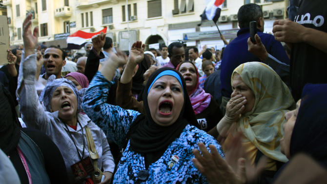 Egyptian women chant slogans during a protest in front of the Judges Club in downtown Cairo, Egypt, Wednesday, April 24, 2013. Egypt's Islamist-led parliament on Wednesday pushed ahead with a controversial judicial law in a heated session, despite a rising uproar among judges and the opposition who fear Islamists' control over courts. (AP Photo/Khalil Hamra)