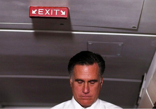 Republican presidential candidate, former Massachusetts Gov. Mitt Romney pauses as he talks with members of the travelling press aboard his campaign plane on November 6, 2012 en route to Boston, Massa
