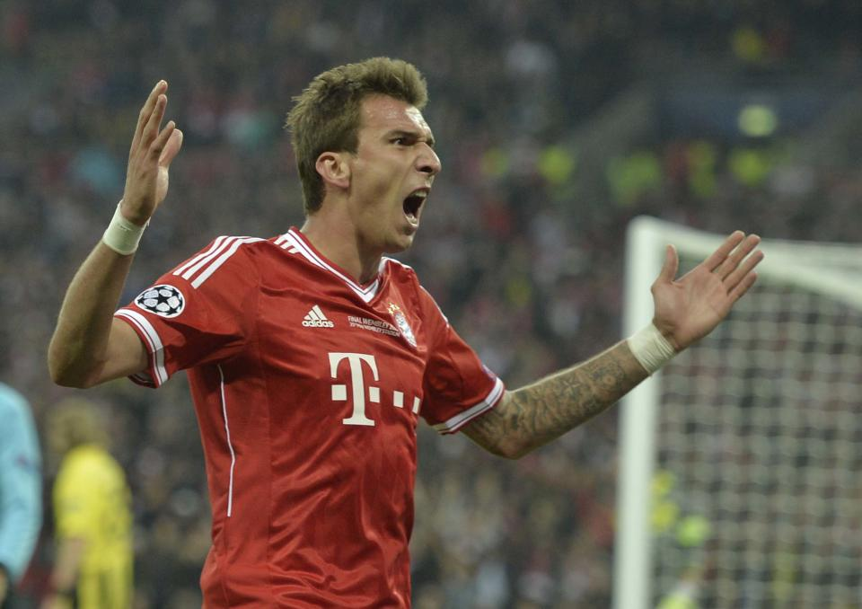 Bayern's Mario Mandzukic of Croatia celebrates scoring during the Champions League Final soccer match between  Borussia Dortmund and Bayern Munich at Wembley Stadium in London, Saturday May 25, 2013. (AP Photo/Martin Meissner)