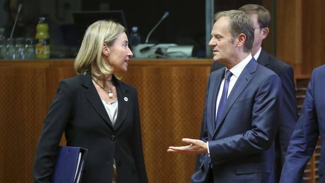 EU foreign policy chief Mogherini talks to EU Council President Tusk during a EU leaders summit in Brussels
