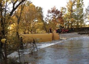 A school bus flipped on its side after it slid off a road and into a creek in Butler County, Kansas
