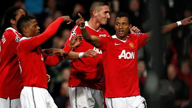 Manchester United's Nani (R) celebrates his goal with team mates during their Champions League match against Bursaspor at Old Trafford in Mancheste