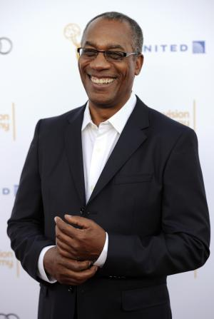 """Joe Morton, an Emmy winner for Outstanding Guest Actor in a Drama Series for """"Scandal,"""" poses at the 66th Emmy Awards Performers Nominee Reception on Saturday, Aug. 23, 2014, in West Hollywood, Calif. (Photo by Chris Pizzello/Invision/AP)"""