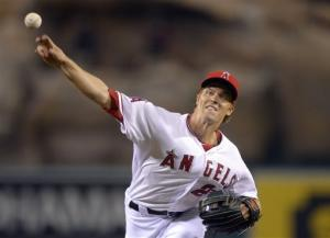 Greinke Ks 13 through 5, Angels edge Seattle 5-4