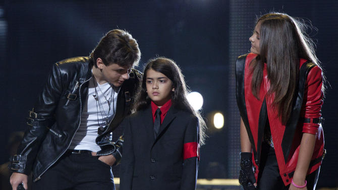 From left, Prince Jackson, Blanket Jackson and Paris Jackson arrive on stage at the Michael Forever the Tribute Concert, at the Millennium Stadium in Cardiff, Saturday, Oct. 8, 2011. (AP Photo/Joel Ryan) EDITORIAL USE ONLY