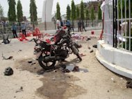 Security personnel at the site of a blast where a bomb attached to a motorbike exploded killing four protesters in the southern city of Janakpur. A group of 150 demonstraters from the Mithila State Struggle Committee had been staging a sit-in when the device went off